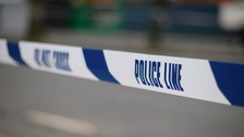 The woman was approached by three men while she was walking down an alleyway.