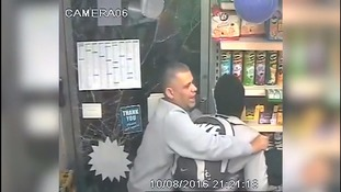 Moment heroic shopkeeper risks his life to protect a teenager from a machete