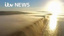 Video: bank of fog flows over Dorset cliffs