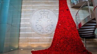 The intelligence agency GCHQ has launched this year's poppy appeal in Gloucestershire with a waterfall of poppies.