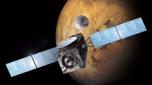 An artist's impression of the Schiaparelli lander approaching Mars.