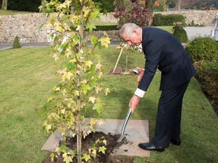 Prince Charles laid a wreath and planted a tree in memory of those killed