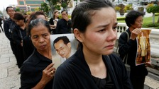 Mourners line up to get into the Throne Hall at the Grand Palace in Bangkok.