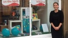 Linda Quinn outside of her shop