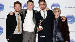 Indie quartet Alt-J celebrate their win.