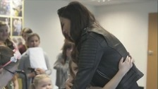 Gracie gets a hug from Nicole Scherzinger.