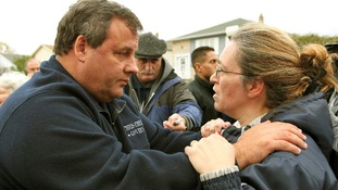 Governor Chris Christie consoles local Alice Cimillo while touring Moonachie, New Jersey