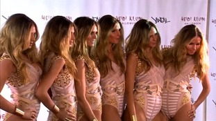 Heidi Klum and five 'clones' arrive in style at Halloween party
