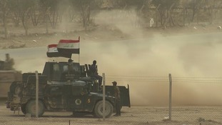 Armoured vehicles advance towards eastern Mosul.