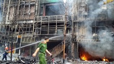 Firefighters work after a fire broke out at a karaoke lounge in Hanoi.