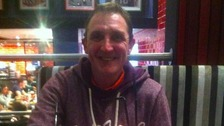 Phillip Owen's body was found in a flat above a hair salon in Urmston on Sunday.