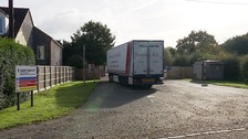 The lorry where fifteen people were found hidden inside in Norfolk
