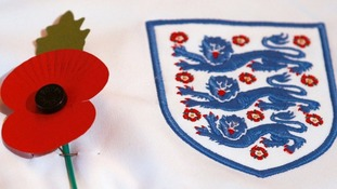 Theresa May slams Fifa's 'utterly outrageous' stance on poppies