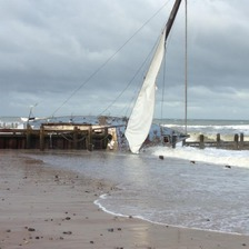 The yacht stranded on the North Norfolk coast has started to break up