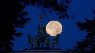 A perigee full moon behind the Brandenburg Gate in Berlin, Germany, in 2015