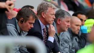 David Moyes sitting with his coaching staff at the Stadium of Light