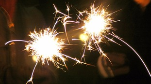 People enjoying sparklers in the run up to November the 5