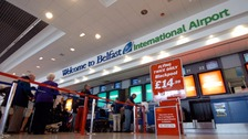 Flights to New York will be cut from Belfast International Airport.