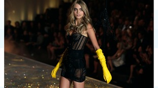 Cara on the catwalk for Victoria's Secret in 2013