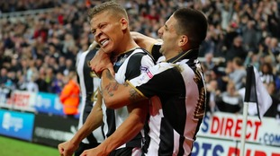 Gayle and Mitrovic celebrate a goal