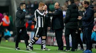 Rafa Benitez talks to his players pitchside