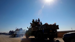 Displaced Iraqis flee during a battle with Islamic State militants in Iraq