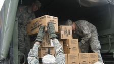 New York Army National Guard Soldiers load meals for emergency food distribution in Brooklyn, New York.