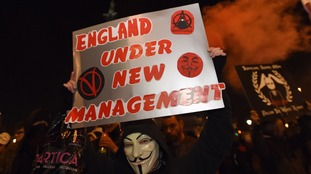 Protestors demonstrate near Trafalgar Square, London, during the Million Mask March