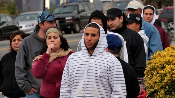 People wait in line to buy gas at a station at Union City, New Jersey.