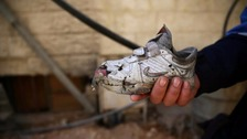A damaged shoe found in the aftermath of the rocket strike.