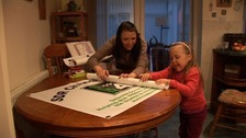 Ria Stonehouse, who has had the surgery, preparing banners with her mum Michelle.