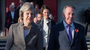 May boards flight to India at Heathrow accompanied by Liam Fox, International Trade Secretary