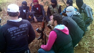 Members of the Free Syrian Army gather as they meet in the outskirts of Taftanaz village