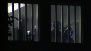 Riot police inside the prison on Sunday.