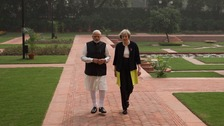 Prime Minister Theresa May and Indian Prime Minister Narendra Modi walk through the gardens of Hyderabad House in New Delhi, India.