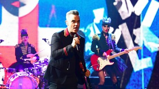 Robbie Williams and Take That reunite for surprise Brit Awards performance