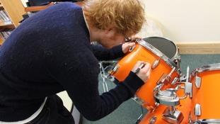 Ed Sheeran signing his drum kit