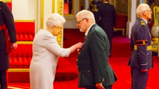 Queen presents West Midlands Ambulance paramedic with MBE