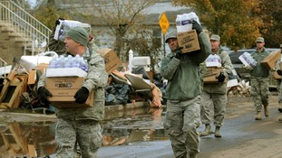 New York Air National Guard taking water and cases of food to local residents in Staten Island