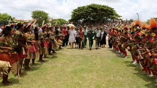 The Prince of Wales and Duchess of Cornwall meet dancers dressed in traditional dress