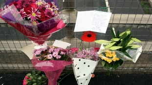 Flowers and tributes left on a bridge overlooking the M5 at Taunton, Somerset.