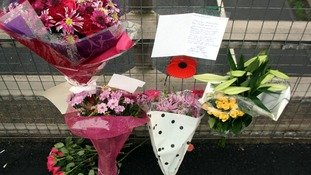 Flowers and tributes left on a bridge overlooking the M5 at Taunton, Somerset. Seven people were killed in the crash exactly one year ago.