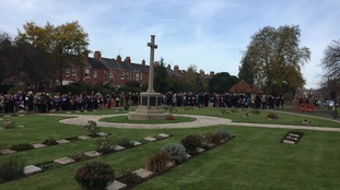 People gathered at a memorial in Exeter