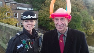 Photos of children's entertainer Alfred Hill, with PC Jayne Marshall.