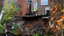 "The sink hole ""with an unknown depth"" which appeared in gardens in Ripon, North Yorkshire."