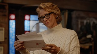 Mrs Claus opens the letter from Jake