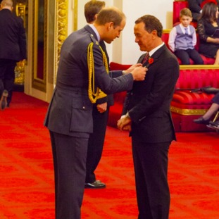 Steve Gibson receives his OBE from the Duke of Cambridge at Buckingham Palace.