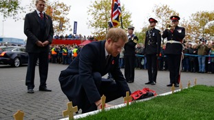 Prince Harry lays a wreath at the grounds of Twickenham stadium.
