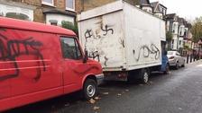 Vans spayed with Swastikas.