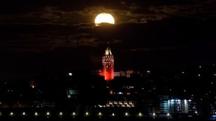 The 'supermoon' is seen over the historical Galata Tower in Istanbul, Turkey.